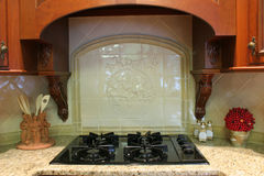 Stove and backsplash. Modern stove with tile backsplash stock images