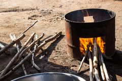 Stove firewood made of gallon tank for cooking. Stock Photo