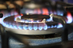 Stove Flames. A closeup view of the flames of a kitchen stove Stock Image