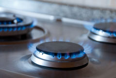 Stove gas. Blue flame of gas on a cooker Royalty Free Stock Photography