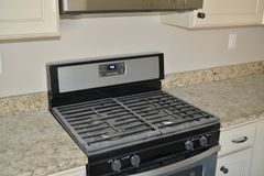 Stove Gas Range top Oven. A gas range has stovetops with dedicated burners for quick boiling and low-temperature simmering cooking Stock Photo