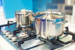 Stove with saucepan on the white modern kitchen Stock Photos