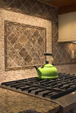 Stove and tea kettle Royalty Free Stock Image
