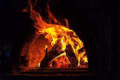 Stove. Wood stove with fire and blaze Royalty Free Stock Photos