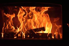Stoves. Burning fire in the fireplace stock images