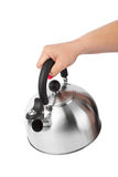 Stovetop whistling kettle in hand Stock Photos