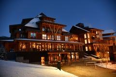 Free Stowe Mountain Ski Resort In Vermont, Empty Spruce Peak Village Log Houses At Night Royalty Free Stock Image - 205924676