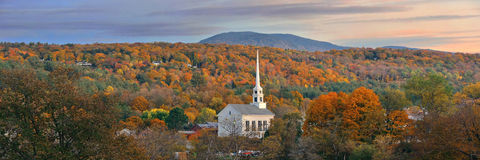 Stowe sunset. Stowe at sunset in Autumn with colorful foliage and community church in Vermont Stock Images