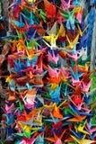 sträcker på halsen origami royaltyfria bilder