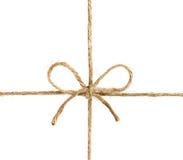 Stränga eller tvinna bundet i en pilbåge som isoleras på vit royaltyfri foto