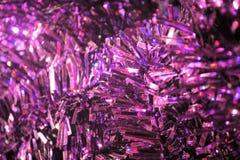 Stränge des purpurroten schimmernden Lamettas Lizenzfreies Stockfoto
