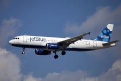 Stråle för Jet Blue flygbolagpassagerare (flygbussen A320) royaltyfri bild