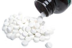 Strömende Pillen heraus Lizenzfreie Stockfotografie