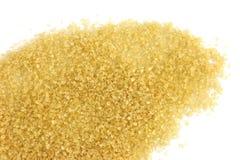 Strösocker farin från sockerröret, bakgrundsströsockerguling, rörsockersocker arkivfoton