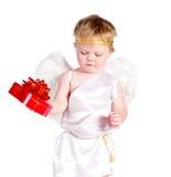 Str.-Valentinsgruß \ 's-Tagesengelsjunge mit Geschenk stockbilder