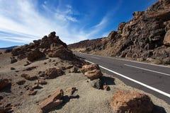 Straße auf den Felsen Stockbild