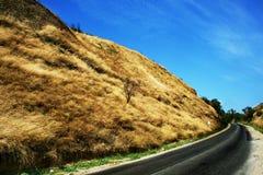 Straße in den Hügeln Stockfotografie