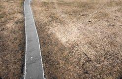 Straße in deprimierender Landschaft Lizenzfreies Stockbild