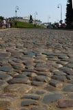 Straße gepflastert mit Stein Stockbilder