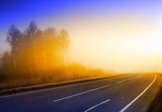 Straße und Sonnenaufgang Lizenzfreies Stockfoto
