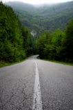 Straße zu den Bergen Lizenzfreie Stockfotografie