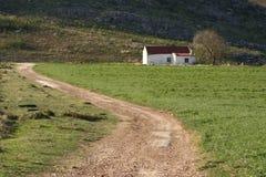 Straße zum Bauernhaus Stockbild