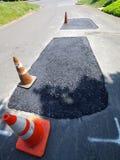 Straßen-Reparatur, frisch Teer mit Steinen 2 Lizenzfreies Stockfoto
