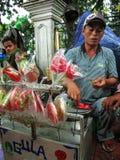 Straßen-Süßigkeits-Verkäufer Stockfoto