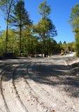 Straßenbau in Maine-Wildnis Stockfotos