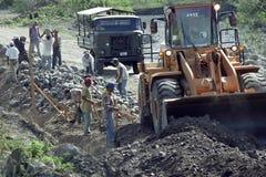 Straßenbau und Straßenbauern in Nicaragua Stockfotografie
