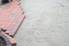 Straßenbetoniermaschinen-Patio-Installation Lizenzfreies Stockbild
