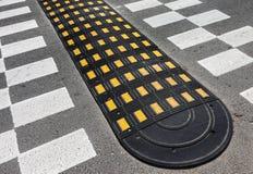 Straßenbremsschwelle Stockbilder