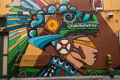 Straßenkunst auf der Wand eines mexikanischen Restaurants Piedra Negra Stockbild