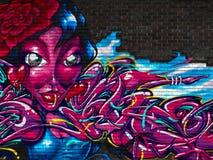Straßenkunst auf einem alten Ziegelstein Lizenzfreies Stockfoto