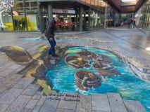 Straßenkunst, die optische Täuschung zeigt Stockfotos