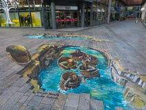 Straßenkunst, die optische Täuschung zeigt Lizenzfreies Stockbild