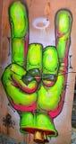 Straßenkunst-Handzeichen bedeutet Stockfotos