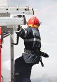 Strażak w akci Fotografia Royalty Free