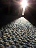 Straal van zonlicht op tapijt Stock Afbeeldingen