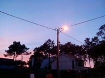 Straat met zonsondergang Stock Afbeeldingen