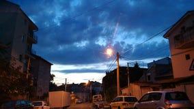 Straat na zonsondergang Stock Foto's