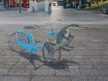 Straatkunst die optische illusie tonen Stock Afbeeldingen