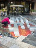 Straatkunst die optische illusie tonen Royalty-vrije Stock Afbeelding