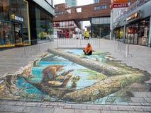 Straatkunst die optische illusie tonen Stock Foto