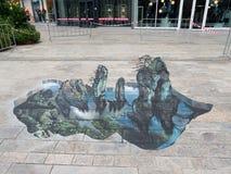 Straatkunst die optische illusie tonen Stock Foto's