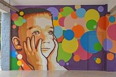 Straatkunst een Jongen Stock Foto's