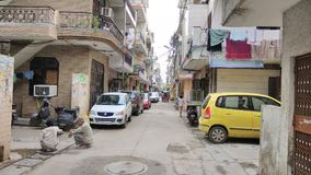 Straatmening met Maruti-Auto's Stock Afbeelding