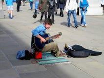 Straatmuzikant (stad van Londen) stock afbeelding