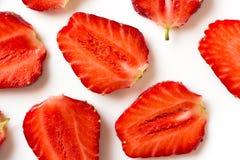 Straberries cortados en blanco Imagen de archivo