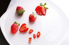 Straberries in different cuts. Strawberries art shot on plate cut in many styles Stock Photo